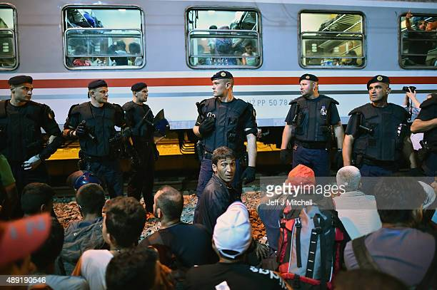 A boy cries as migrants board an evening train to Zagreb from Tovarnik station on their journey north despite moves by Slovenia and Hungary to hold...