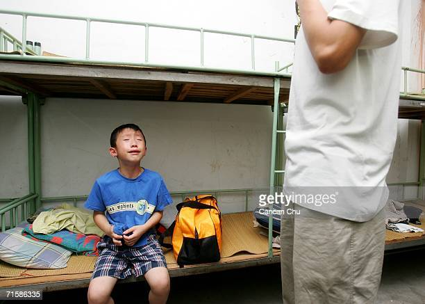A boy cries because he misses his mother at the West Point Training Center July 31 2006 in Hangzhou Zhejiang province of China The center named after...