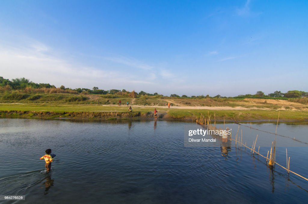 A boy crossing the river : Stock Photo