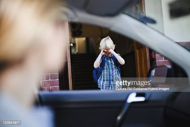 Boy crying and going to school