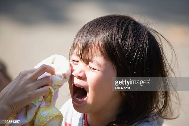 Boy Crying and Mother Wiping Tears
