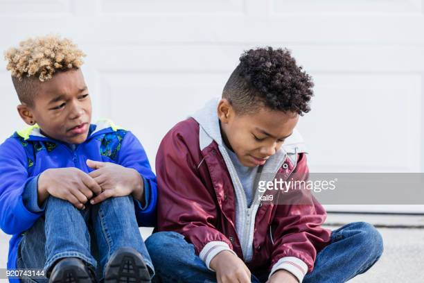 boy crying, brother looks worried - sibling stock pictures, royalty-free photos & images