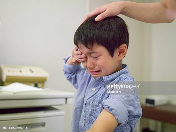 Boy (5-6) crying in hospital