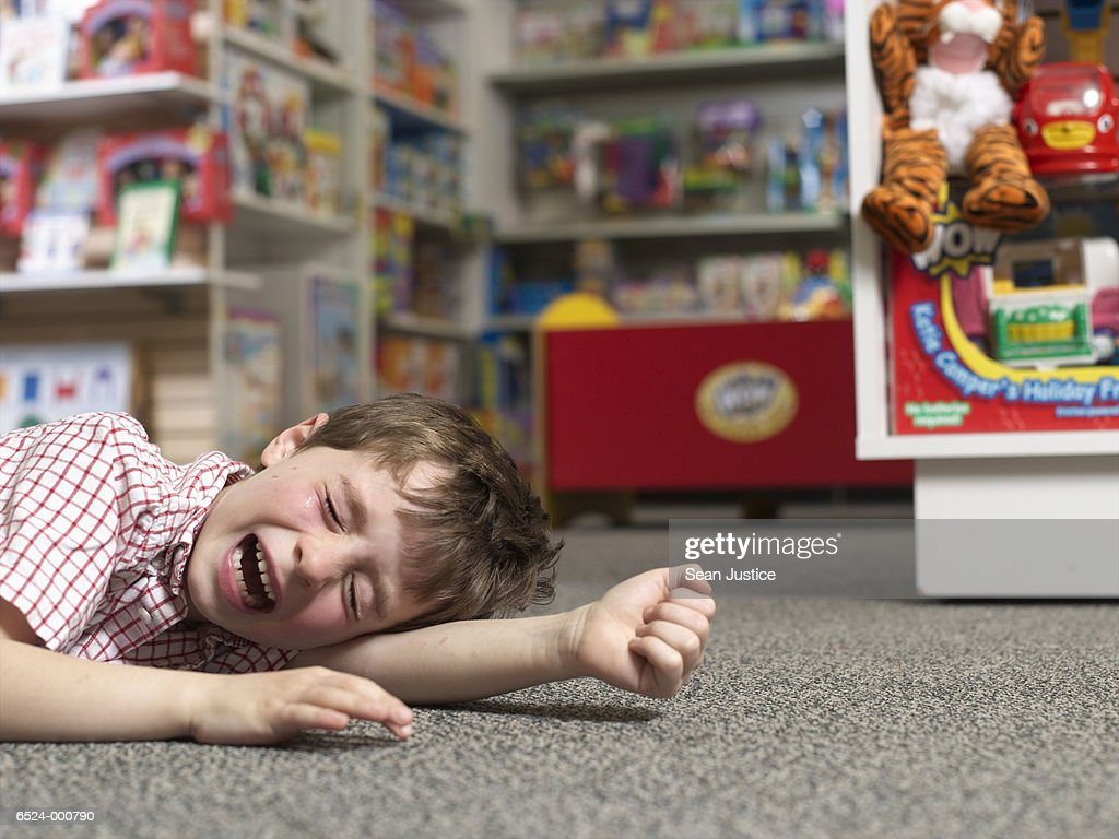 Boy Crying in Toy Store : Stock Photo