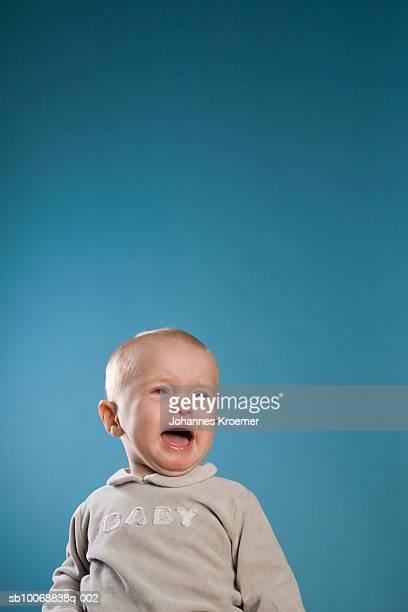 Boy (12-17 months) crying, studio shot