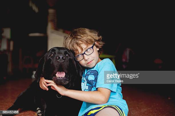 Boy Cuddling with Dog