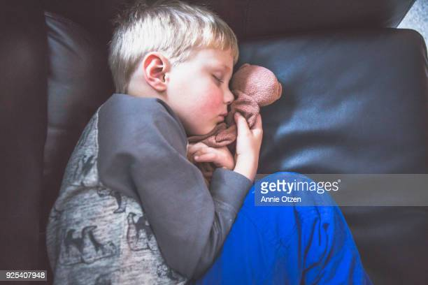 Boy Curled up Sleeping in a Chair