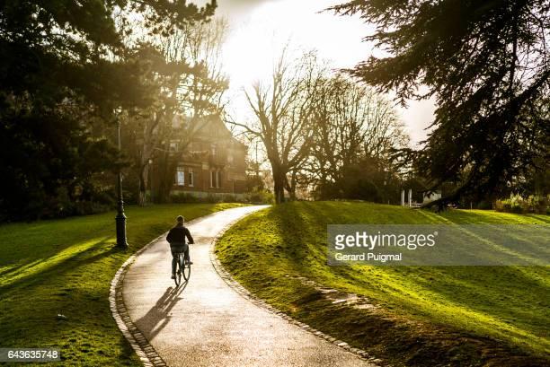 Boy cycling in Parc des Buttes-Chaument (Paris)