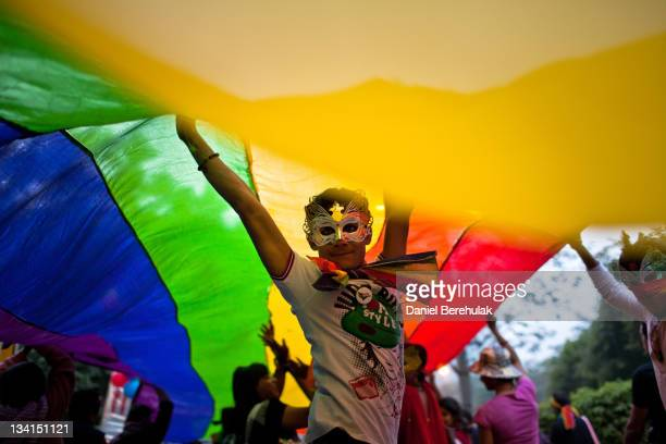 A boy dances as he and others participate during the 4th Delhi Queer Pride 2011 March on November 27 2011 in New Delhi India India's Lesbian Gay...