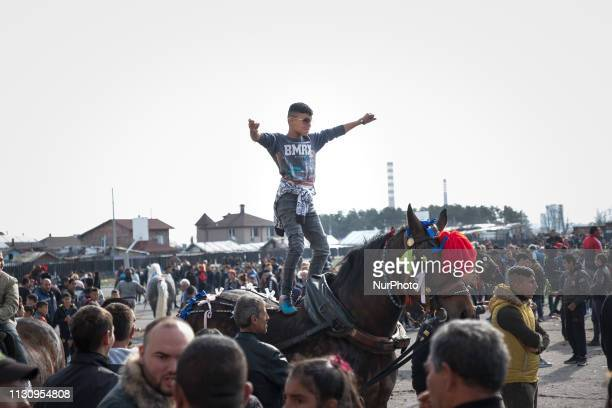 A boy dances on top of his horse during Horse Easter celebrations in the Fakulteta neighborhood of Sofia March 16 2019 which is celebrated on St...