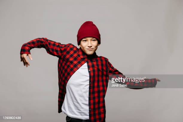 boy dancing against a grey background - dancer stock pictures, royalty-free photos & images