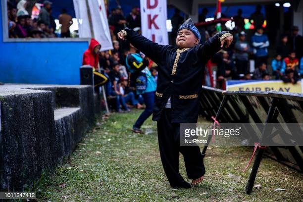 A boy dancing during a Sundanese traditional cultural event called Adu Domba Garut at Rancabango village in Garut West Java Indonesia on Saturday...