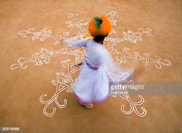 boy dancing on decorated floor - hugh sitton india stock pictures, royalty-free photos & images