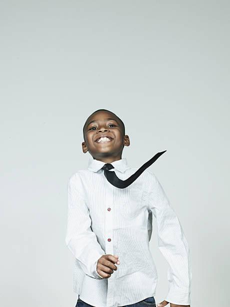 Boy (6-7) dancing, smiling, portrait