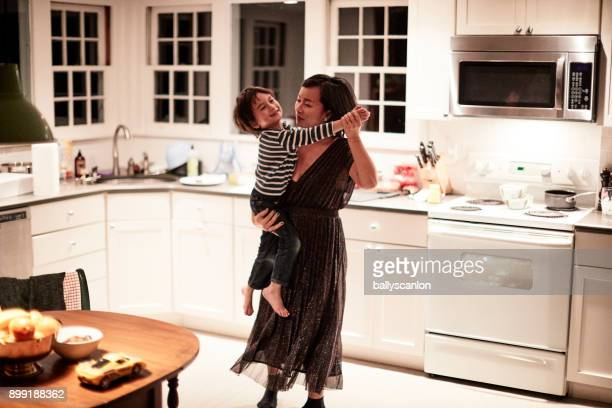 Boy Dancing With Mother In Kitchen