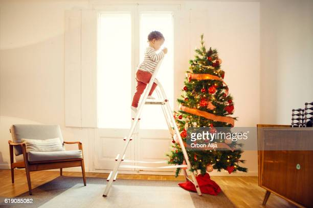 Boy decorating Christmas tree