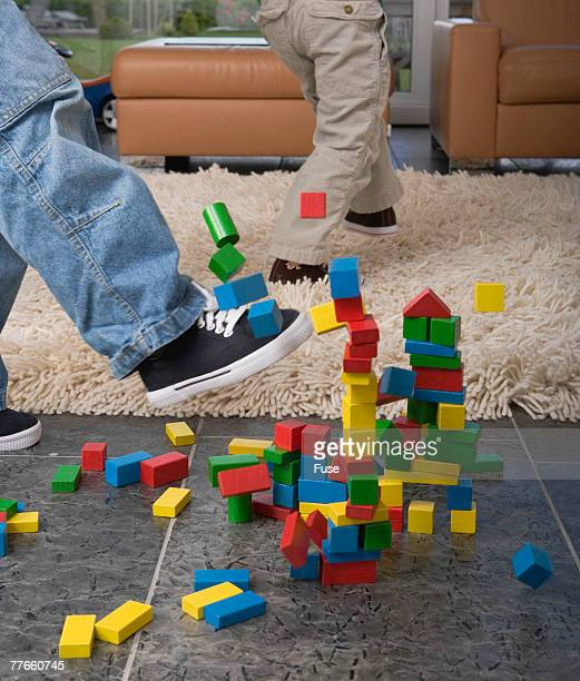 Boy Deleting House of Building Blocks