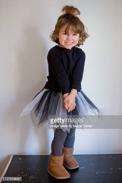 boy delighted wearing a girl's costume - ankle length stock pictures, royalty-free photos & images