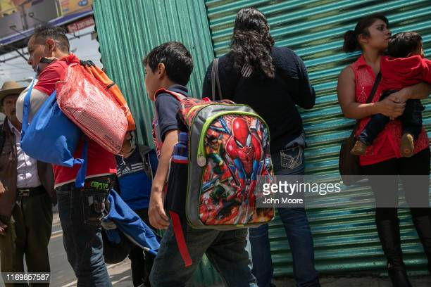 Boy departs the airport with his father after arriving on an ICE deportation flight from the U.S. On August 22, 2019 in Guatemala City, Guatemala....
