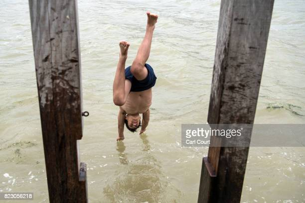 A boy dives into the sea on July 26 2017 in Broadstairs England Broadstairs is known as the 'jewel in Thanet's crown' and is a popular destination...