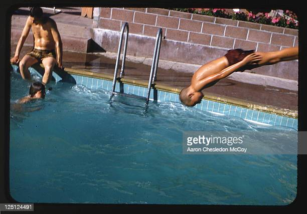 Boy diving into pool