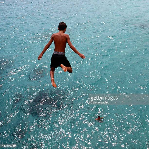 Boy diving into water
