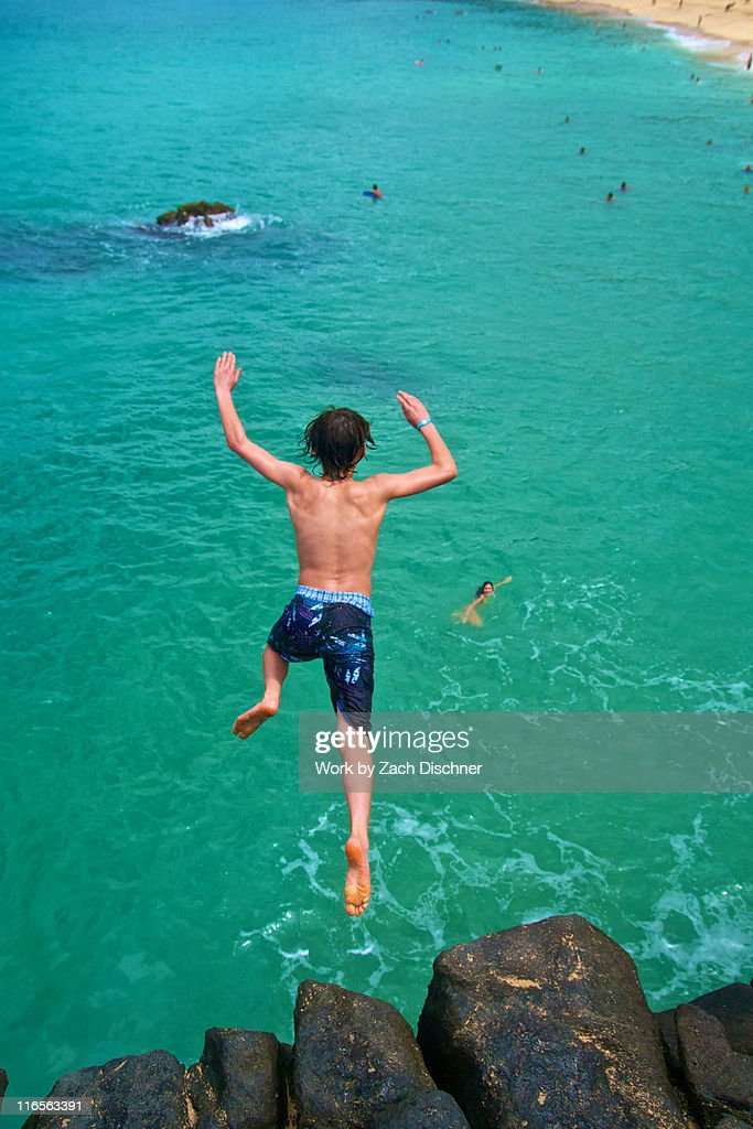 Boy diving : Stock Photo