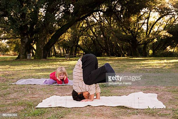 boy doing headstand - jessamyn harris stock pictures, royalty-free photos & images