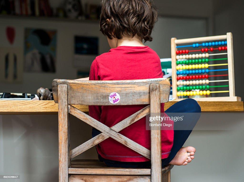 Boy doing his homework at home : ストックフォト