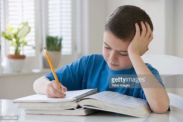 Boy doing homework at table