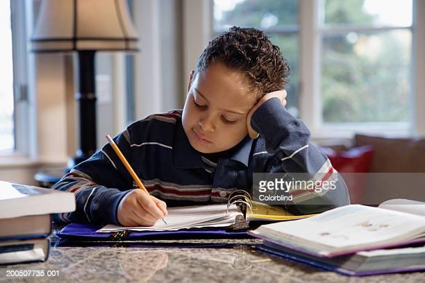 Boy (9-11) doing homework