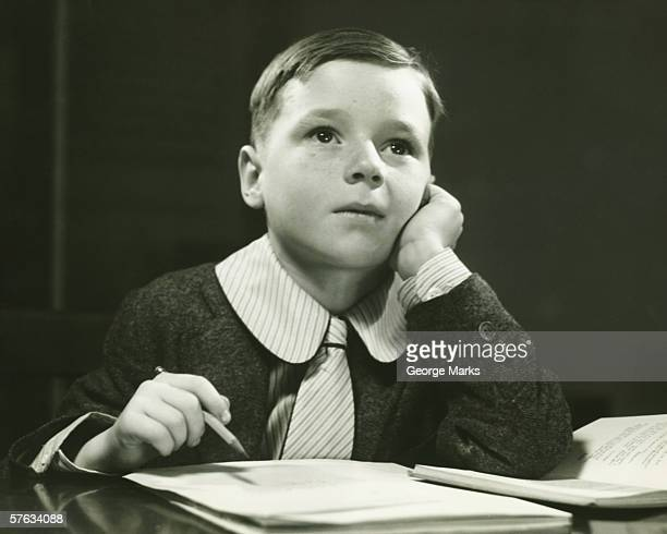 boy (6-7) doing homework, (b&w), portrait - schoolboy stock pictures, royalty-free photos & images