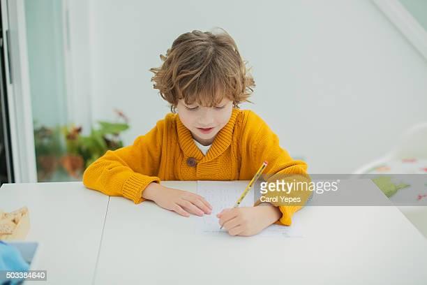 boy doing some homeworks
