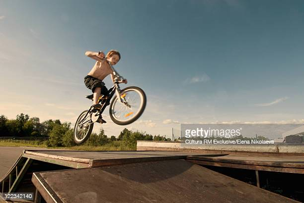 Boy doing tricks on bike