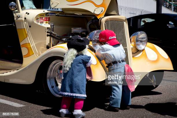 Boy doll and girl doll dressed as mechanics at a vintage 1934 Ford Roadster at Belmont Parks Fathers Day Car Show in Mission Beach