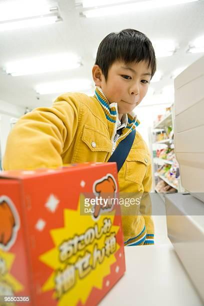 Boy drawing a raffle ticket