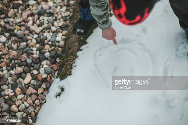 boy drawing in snow - sioux falls stock pictures, royalty-free photos & images