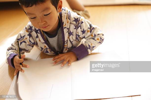 A boy drawing