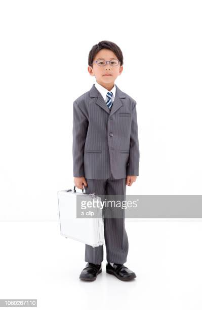 a boy dressed as a businessman - adult imitation stock pictures, royalty-free photos & images