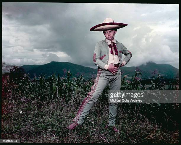 A boy dressed as a Caballero pose in Acapulco Mexico in July 1953