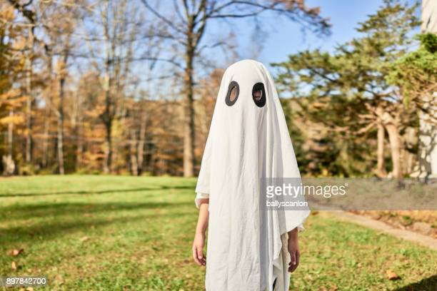 Boy Dressed As A Ghost For Halloween.