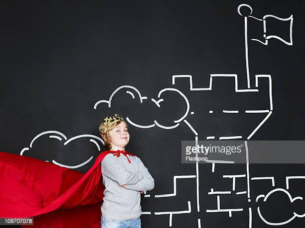 boy dressed as a king outside his castle - king stock pictures, royalty-free photos & images