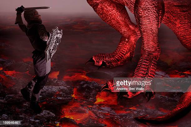 boy dressed as a knight fights a dragon - dragon stock photos and pictures