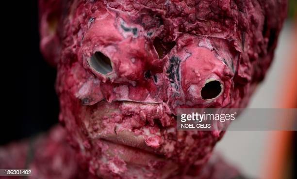A boy dressed as a monster participates in an annual Halloween Costume Parade in Manila on October 30 2013 The activity aims to celebrate Halloween...