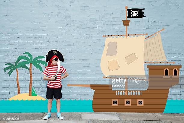 Boy dressed as a pirate with cartoon ship