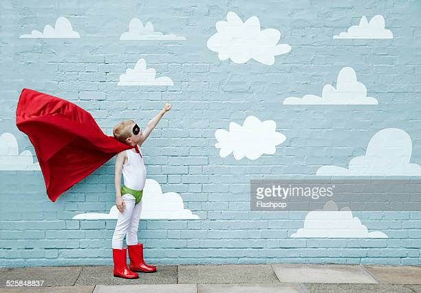 boy dressed as a superhero - erwartung stock-fotos und bilder