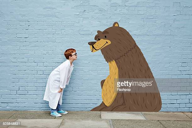 Boy dressed as a vet with cartoon bear