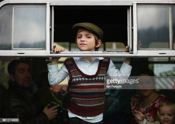 A boy dressed as a war evacuee looks out from the window of a railway carriage during the North Yorkshire Moors Railway 1940's Wartime Weekend event...