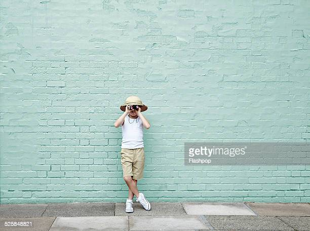 boy dressed as an adventurer with binoculars