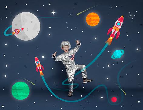 Boy dressed as an astronaut. Cartoon space scene - gettyimageskorea